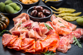 Platter of antipasti with a mixture of salami, prosciutto, bocconcini, peppers, tomatoes and olives - PhotoDune Item for Sale