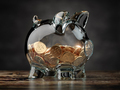 Piggy bank with golden coins. Financial investment, savings and family budget concept background. - PhotoDune Item for Sale