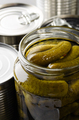Canned pickles in just opened glass mason jar. Non-perishable food - PhotoDune Item for Sale