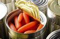 Canned baby carrots in just opened tin can. Non-perishable food - PhotoDune Item for Sale