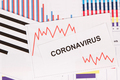 Inscription coronavirus and declining chart as risk of financial crisis caused by virus - PhotoDune Item for Sale