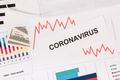 Inscription coronavirus, dollars and downward graphs - PhotoDune Item for Sale