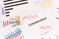 Inscription coronavirus, euro and downward graphs representing financial crisis caused by Covid-19 - PhotoDune Item for Sale