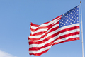 American flag waving in the wind on blue sky - PhotoDune Item for Sale
