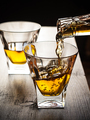 Whisky being poured in a glass - PhotoDune Item for Sale