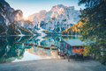 Boats  and wooden house on the water on coast of Braies lake - PhotoDune Item for Sale