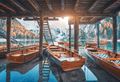 Wooden boats under the house in famous Braies lake at sunrise - PhotoDune Item for Sale