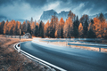 Blurred car on winding road in mountains in overcast evening - PhotoDune Item for Sale