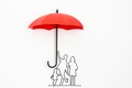 Family protection insurance concept using red umbrella - PhotoDune Item for Sale