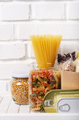 Set of uncooked foods on pantry shelf prepared for disaster emergency conditions closeup view - PhotoDune Item for Sale