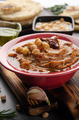 Fresh homemade Hummus in clay dish topped with olive oil - PhotoDune Item for Sale