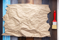 wrinkled paper at wooden board  background - PhotoDune Item for Sale
