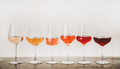 Shades of Rose wine in glasses on concrete table - PhotoDune Item for Sale