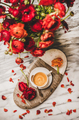 Cup of coffee on serving board and red ranunculus flowers - PhotoDune Item for Sale
