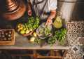 Woman adding fresh mint to homemade citrus lemonade - PhotoDune Item for Sale