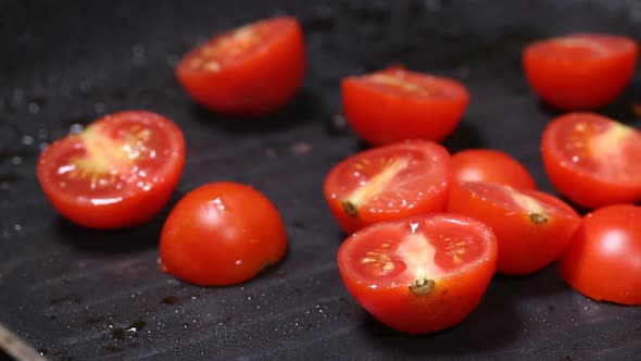 Grilling pieces of cherry tomatoes