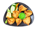 portion of indian samosas on black plate isolated - PhotoDune Item for Sale