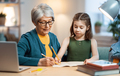 Girl studying with grandma. - PhotoDune Item for Sale