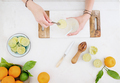 Citrus infused water preparation. Fresh oranges and limes - PhotoDune Item for Sale