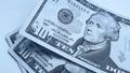 Banknotes of ten american dollars, blue toned image - PhotoDune Item for Sale