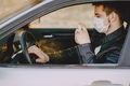 Man in a mask disinfect the car - PhotoDune Item for Sale