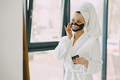 Beautiful girl in a white bathrobe at home - PhotoDune Item for Sale