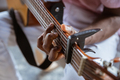 Close up of african-american musician playing guitar during online concert at home isolated and - PhotoDune Item for Sale