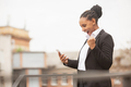 African-american businesswoman in office attire smiling, looks confident and happy, successful - PhotoDune Item for Sale