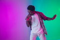 African-american male singer portrait isolated on gradient studio background in neon light - PhotoDune Item for Sale