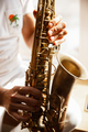 Close up of caucasian musician playing saxophone during concert at home isolated and quarantined - PhotoDune Item for Sale