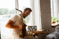 Caucasian musician preparing for concert at home isolated and quarantined, impressive improvising - PhotoDune Item for Sale