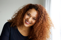 Close up beautiful young black woman with curly hair - PhotoDune Item for Sale
