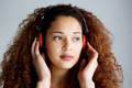 african american woman listening to music with headphones - PhotoDune Item for Sale
