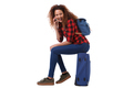 Side portrait of happy travel woman sitting on suitcase and talking on cellphone - PhotoDune Item for Sale