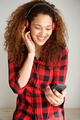 young woman listening to music with mobile phone and headphones - PhotoDune Item for Sale