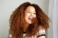 young african american woman with curly hair laughing - PhotoDune Item for Sale