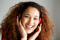Close up happy young african american woman smiling and listening to music with headphones - PhotoDune Item for Sale