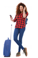 Full body female traveler with bags looking at cellphone - PhotoDune Item for Sale