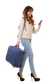 travel woman walking with bags and mobile phone against isolated white background - PhotoDune Item for Sale