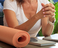 Woman and an exercise mat in an office background - PhotoDune Item for Sale