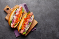 Hot dog with vegetables, lettuce and condiments - PhotoDune Item for Sale