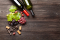 Various grapes, wine bottles and corkscrew - PhotoDune Item for Sale
