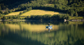 Woman fishing on a boat. - PhotoDune Item for Sale