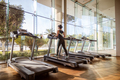 Woman running on treadmill in gym. Ealthy lifestyle. - PhotoDune Item for Sale