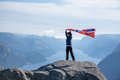 Woman with a waving flag of Norway on the background of nature - PhotoDune Item for Sale