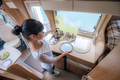 Woman cooking in camper, motorhome interior - PhotoDune Item for Sale