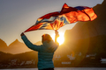 Woman waving the flag of Norway at sunset - PhotoDune Item for Sale