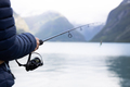 Woman fishing on Fishing rod spinning in Norway. - PhotoDune Item for Sale