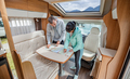 Couples in RV Camper looking at the local map for the trip. - PhotoDune Item for Sale