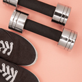 Metal small dumbbells and sneakers for training on a pink background - PhotoDune Item for Sale